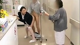 Asian nurse services patient in public hospital