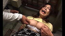 Asian woman tied with rope gets her pert tits spanked by two guys