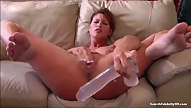 Girl having fun with a big dildo