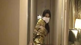Koganezaki Chihiro bound and OTN gagged, struggling in her golden dress