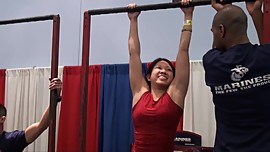 Asian chick doing some pull ups