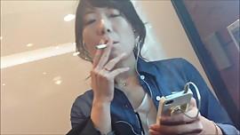 Lovely Japanese girl smoking 291