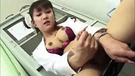 Asian nurse tranny jerks off at work