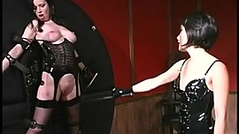 Asian dominatrix playing with her slave's tits and pussy