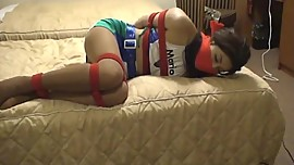 Bound and gagged Japanese on a bed